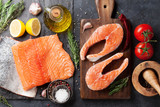 Raw salmon fish steaks and fillet - 216706519
