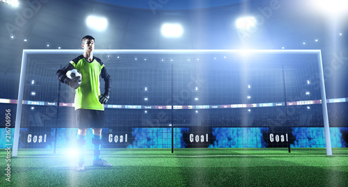 Young soccer player with ball in front of the goal on a professional 3D stadium - 216706956