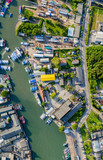 aerial at Phuket fishing port and Phuket shipyard. Phuket Fishing Port is the largest fishing port .located in Sirey Island next to Phuket Island. There is a large canal leading to the sea.