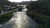 Aerial footage of a river overflowing in norway - 216720306