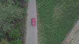 Red old car aerial drone shot. - 216723395