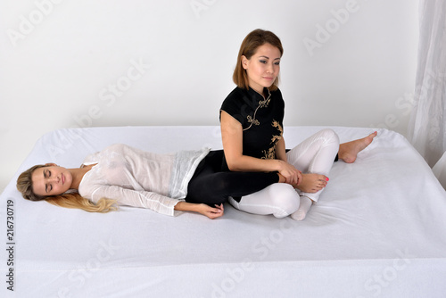Foto Murales Thai Massage. Massage therapist working with woman