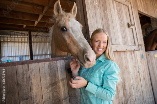 Happy Woman and Palomino Horse