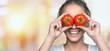 Leinwanddruck Bild - Beautiful laughing woman holding two ripe tomatoes