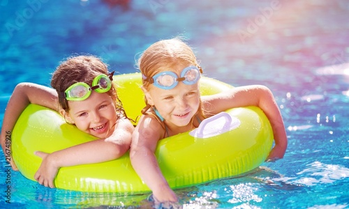 Children playing in pool - 216748926