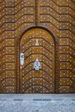 Fancy wooden door with steel rivets - 216768586