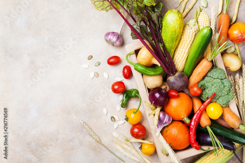 Autumn farm vegetables and root crops on wooden box top view. Healthy and organic food.