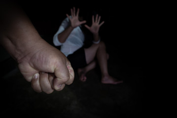 Woman victim of domestic violence and abuse. Focus on hand