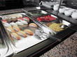 trays with varieties of sushi with rice and salmon in the restau