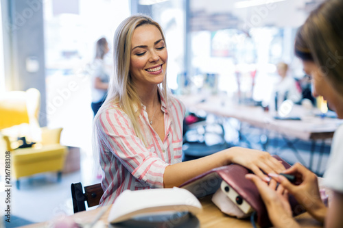 Canvas Manicure Manicure care procedure, Woman in a nail salon receiving a manicure