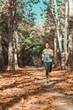Leinwanddruck Bild - Woman Jogging Outdoors in The Fall