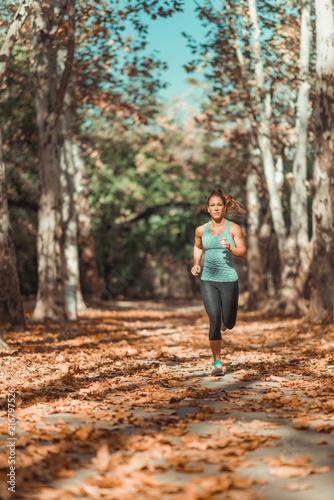 Leinwanddruck Bild Woman Jogging Outdoors in The Fall