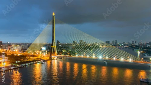 Fototapeta Time lapse of Big Suspension bridge with lighting in sunset time / Rama 8 bridge in sunset time
