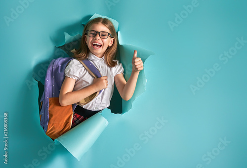 child breaking through color wall