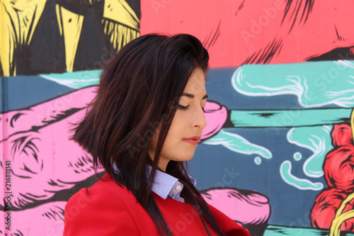 Woman in red Portrait - standing in front of wall with graffiti