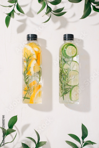 Foto Murales Variety of infused detox water isolated on white, health concept