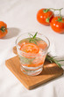 Quadro Delicious refreshing water with rosemary and tomato in glass on table