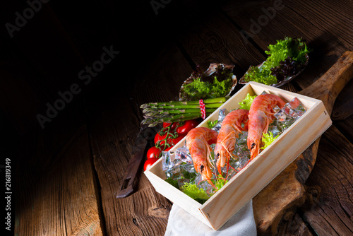 Fototapeta cooked argentine red prawns with salad on the ice