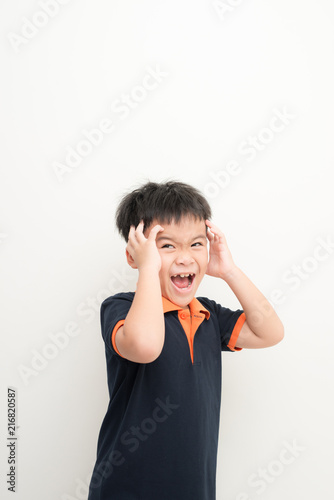 Foto Murales Cute little boy covering ears with hands, on white background