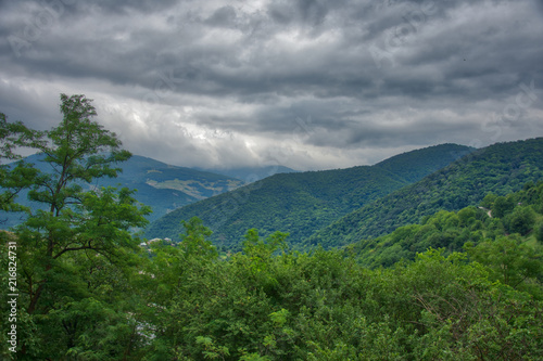 Foto Spatwand Donkergrijs Mountain landscape view with clouds