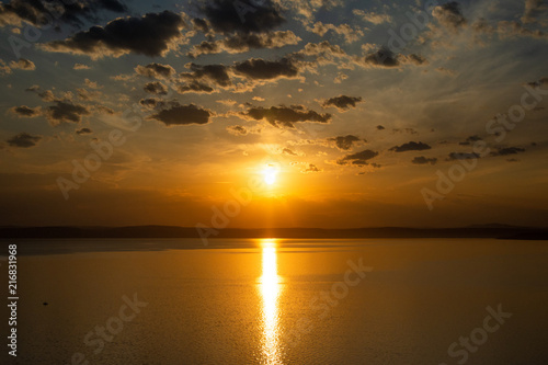 Fotobehang Zee zonsondergang Sunset over the lake Balaton in Hungary