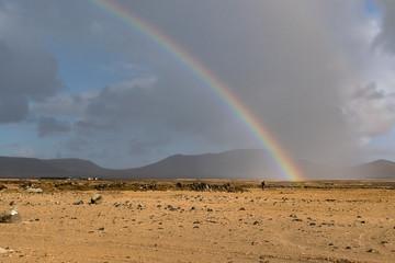 arcobaleno sulla sabbia