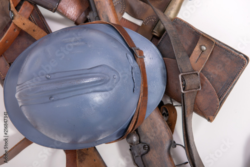 Foto Murales french military helmet of the First World War with rifle on white