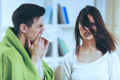 Leinwanddruck Bild Sick Brunette Male at Cute Shocked Girl.