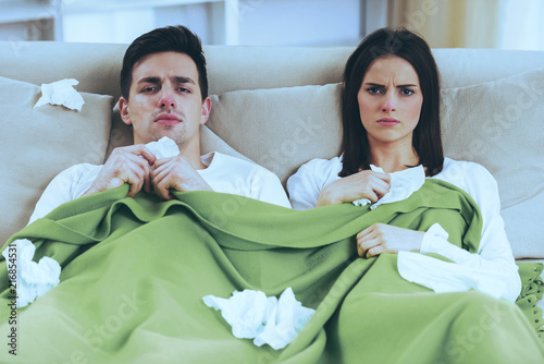 Leinwanddruck Bild Young Couple Under Blanket.