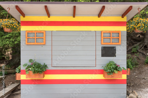 Foto Murales Colorful abstract small wooden house. Closed little shop