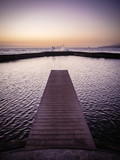 Jetty leading to the ocean at dusk with waves splashing against the sea wall in Tenerife - 216869957