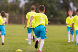 Young children players football match on soccer field - 216870791