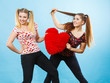 Quadro Happy two women holding heart shaped pillow