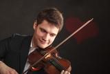 Man man dressed elegantly playing violin - 216875127