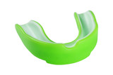 green sports mouth guard, protection of teeth in box of rubber on white background, isolate