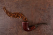 Old smoking pipe and tobacco on a vintage background. Above