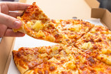 Close up of tasty hawaiian pizza with ham and pineapple - 216881930