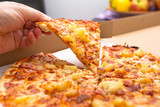 Close up of tasty hawaiian pizza with ham and pineapple
