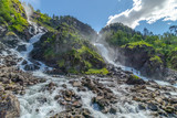 Langfossen waterfall in Norway at sunny summer day