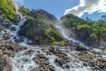 Langfossen waterfall in Norway at sunny summer day © Aleksandr