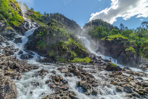 Langfossen waterfall in Norway at sunny summer day - 216895193