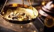 Leinwandbild Motiv Small gold nuggets in an antique measuring