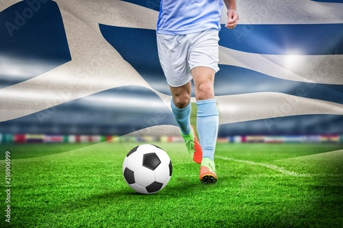 Fotobehang Voetbal Composite image of male soccer player playing football