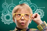 Young boy in glasses on blackboard background - 216908767