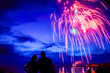 Fireworks over lake michigan at dusk, motion blur on couple