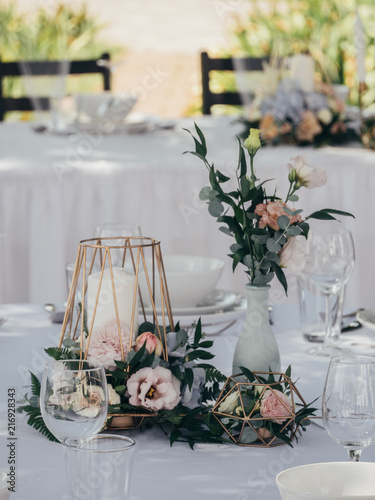 Creative wedding decoration on wedding table - 216928343