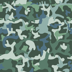 Camouflage pattern background seamless vector illustration. Classic clothing style masking camo repeat print. Green colors forest texture.  © Юрий Парменов