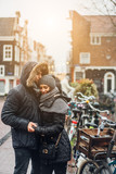 guy and girl in the street in the rain - 216932984