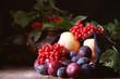 калина и фрукты свежие лежат на столе натюрморт