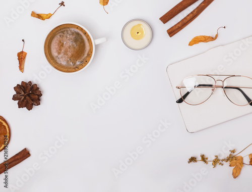 Autumn flat lay with coffee, candle and yellow leaves - 216938524